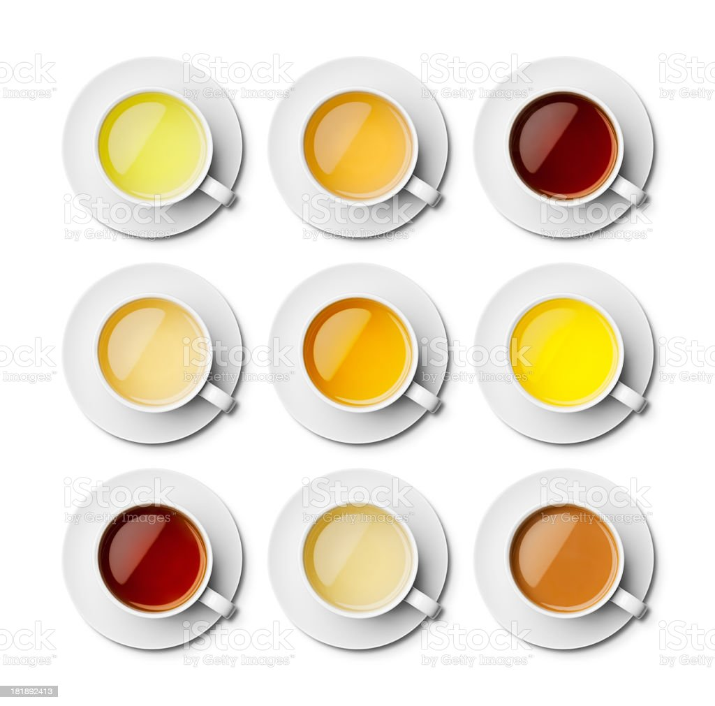 Different teas in white cups with saucers overhead stock photo