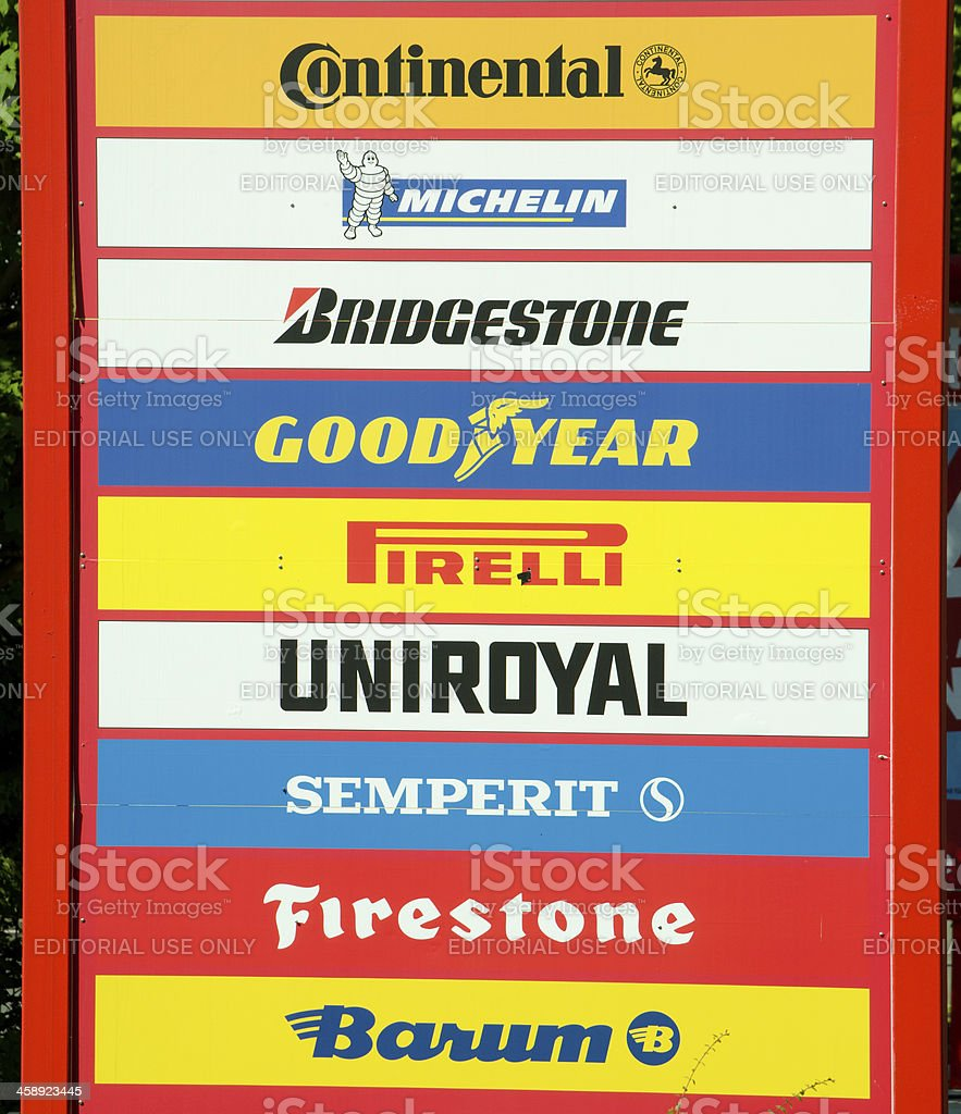 different tire manufacturer at a sign stock photo