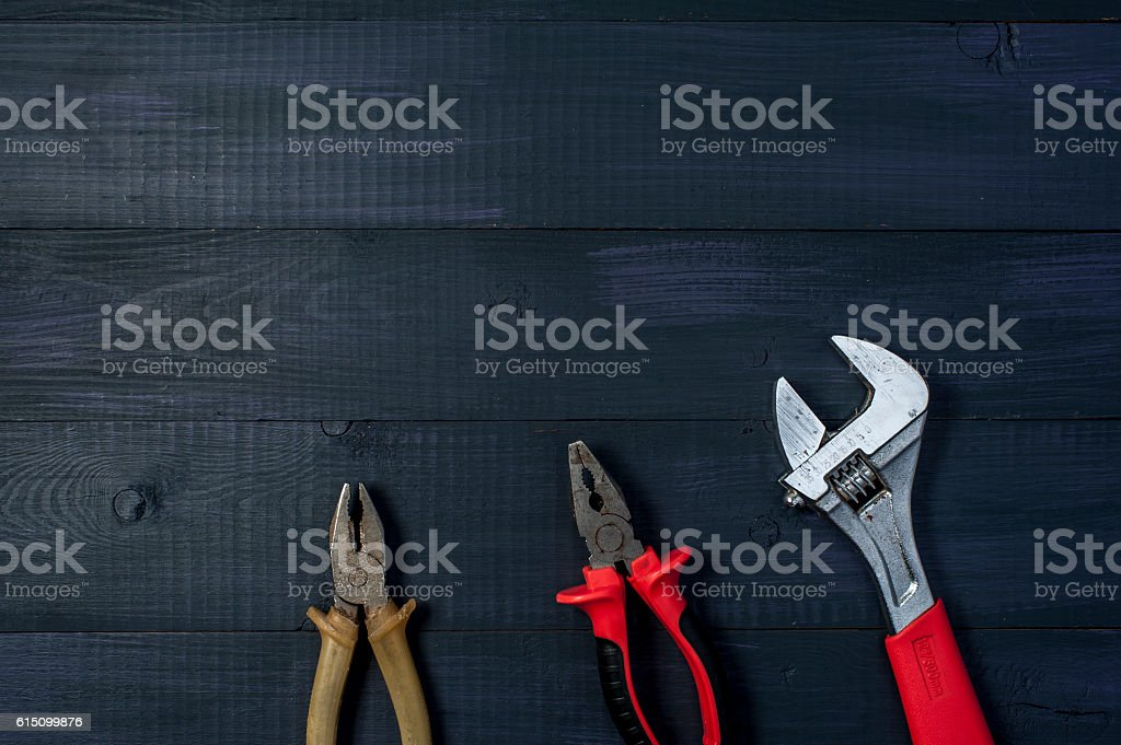 Different tools on wooden background stock photo