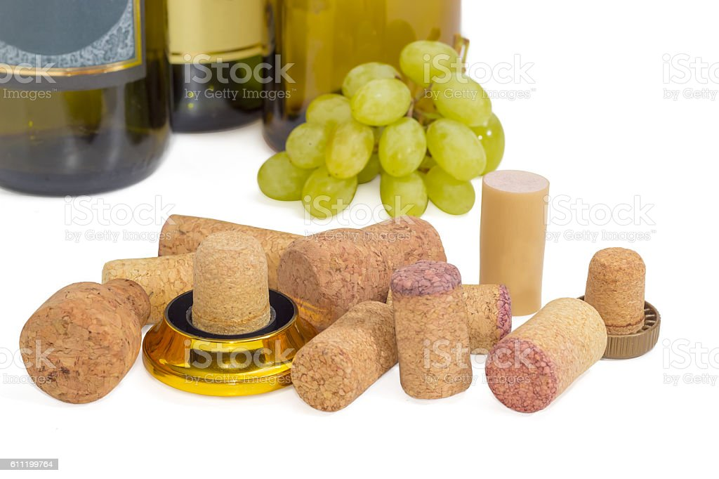 Different traditional and synthetic wine corks on a light backgr stock photo