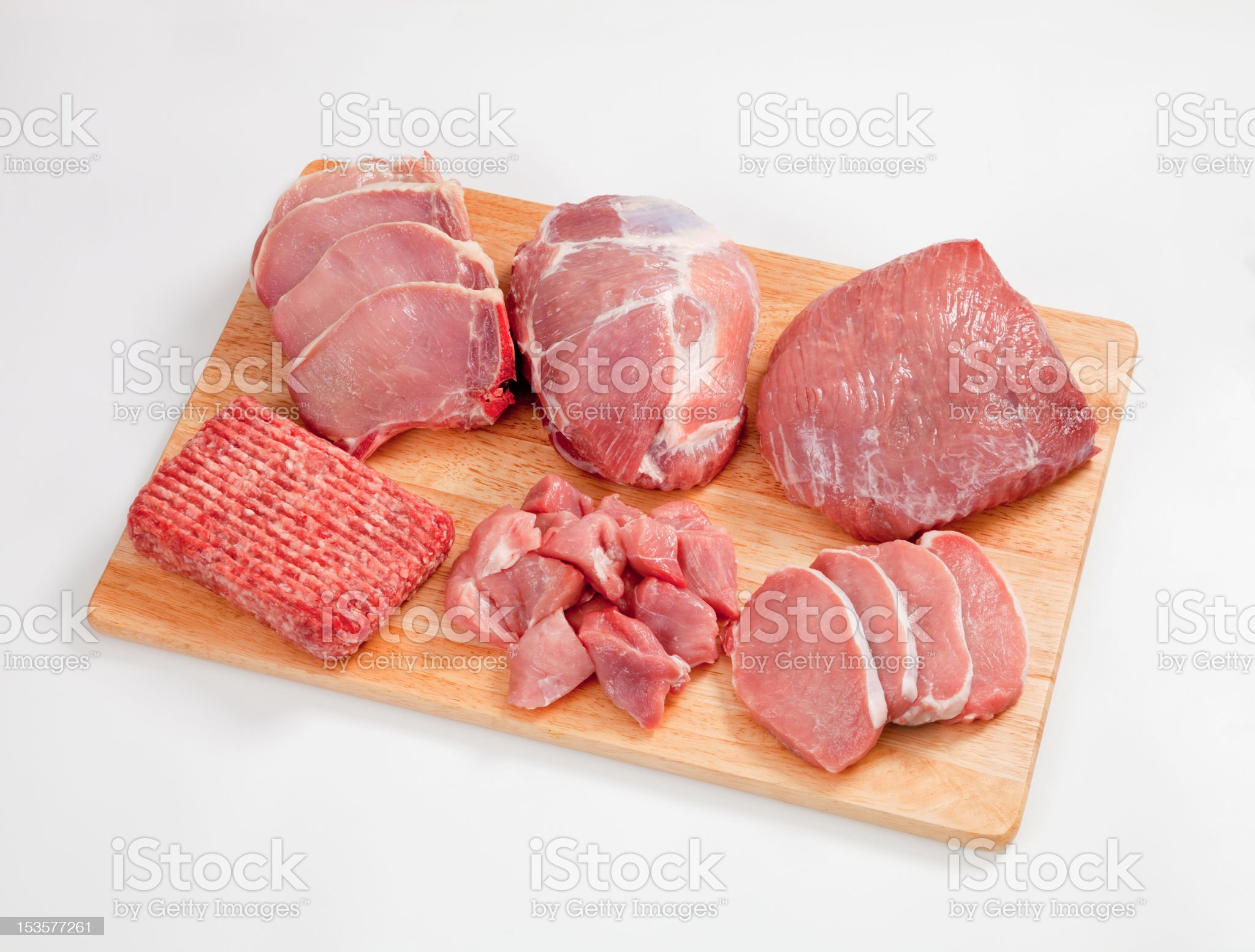 Different type of raw meat on a chopping board royalty-free stock photo