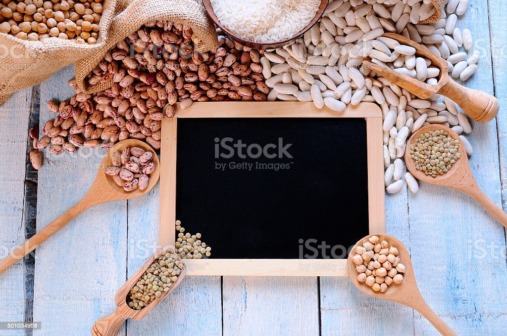 Different types of beans around black framed. stock photo