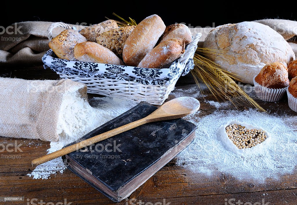 Different types of bread, fruit cakes, scattered flour, recipe b stock photo