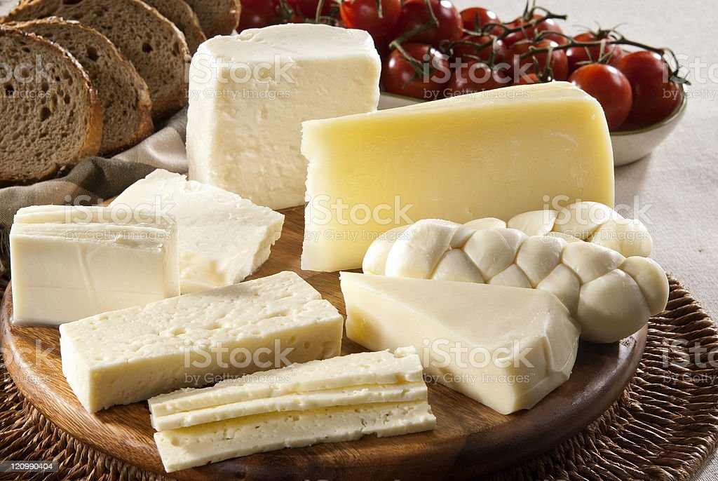 Different types of cheese, bread and tomatoes stock photo