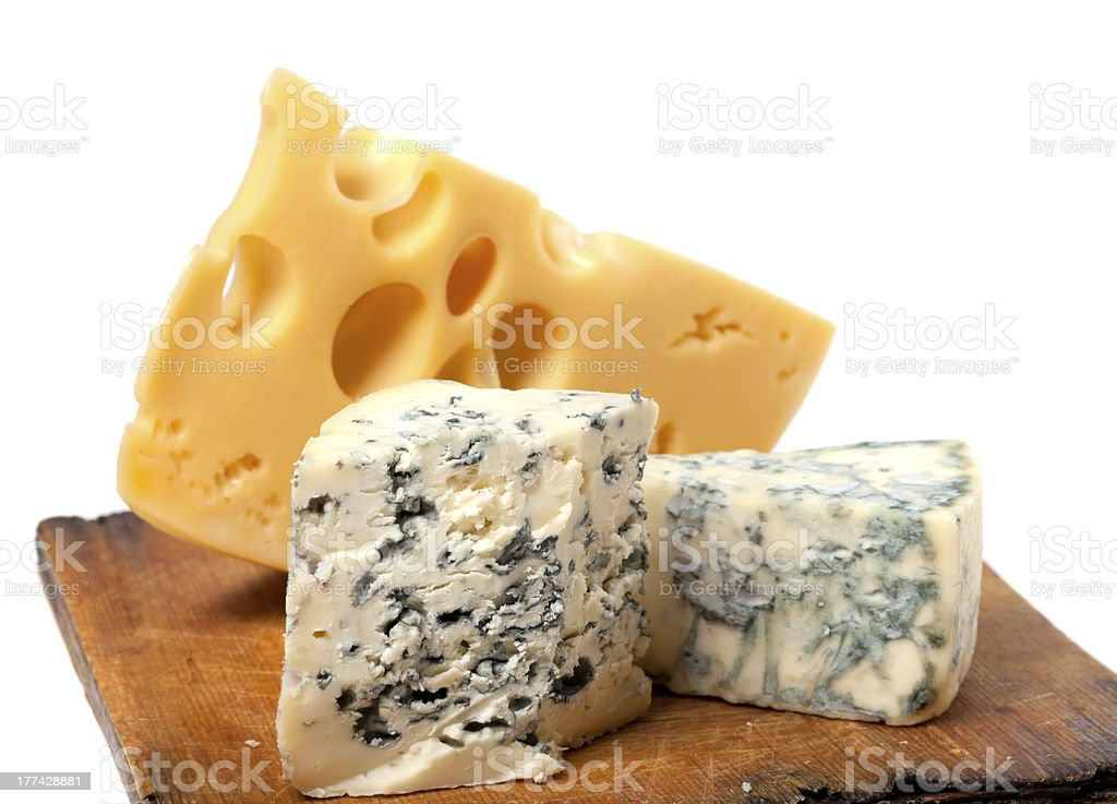 Different types of cheese on wooden kitchen board royalty-free stock photo