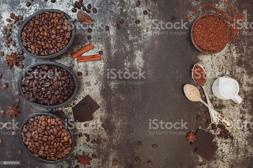 Different types of coffee and spices on rustic surface stock photo