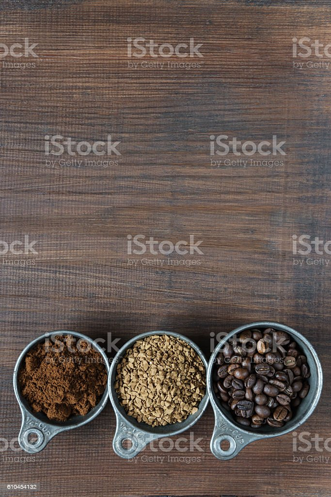 Different types of coffee on a wooden background stock photo