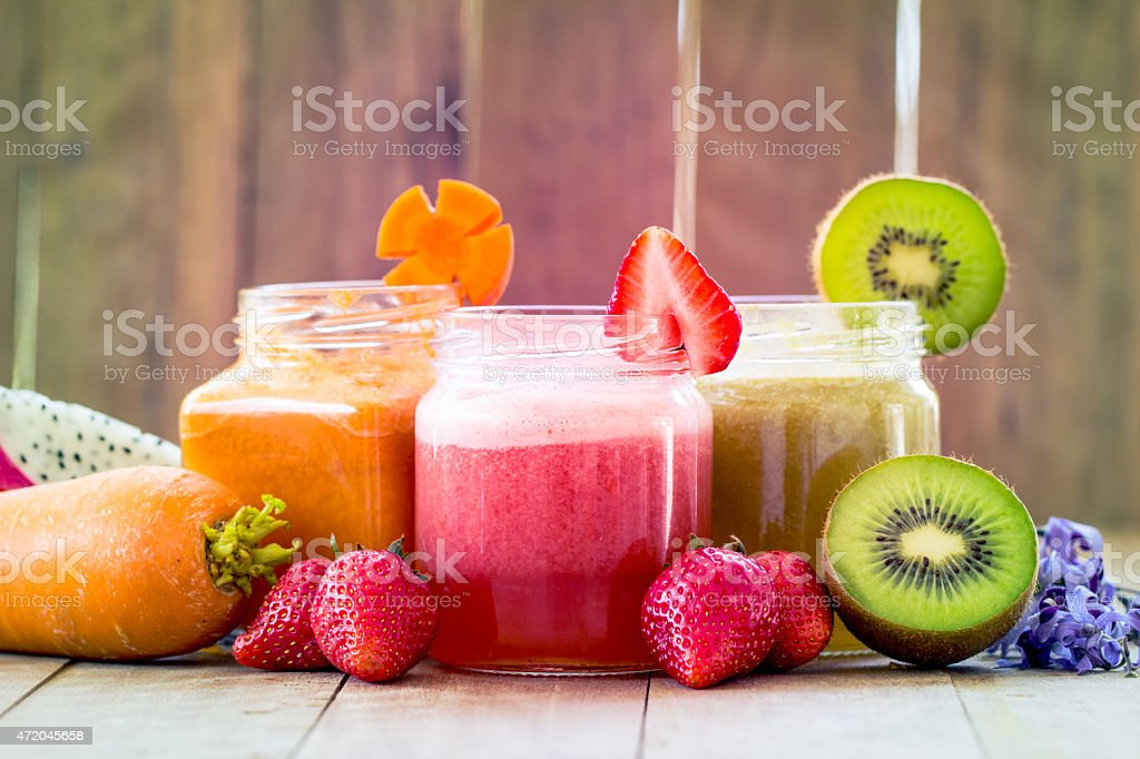 Different types of fruit and vegetables smoothies stock photo