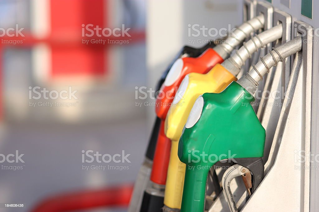 Different types of fuel pumps identified with colors stock photo