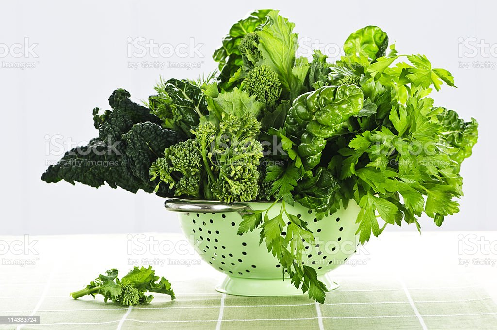 Different types of green vegetables in a stainless colander stock photo