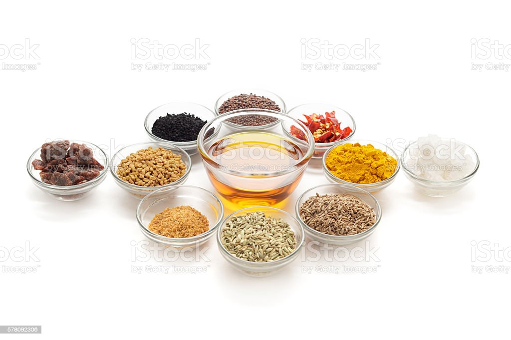 Different types of Indian spices in glass bowls. stock photo
