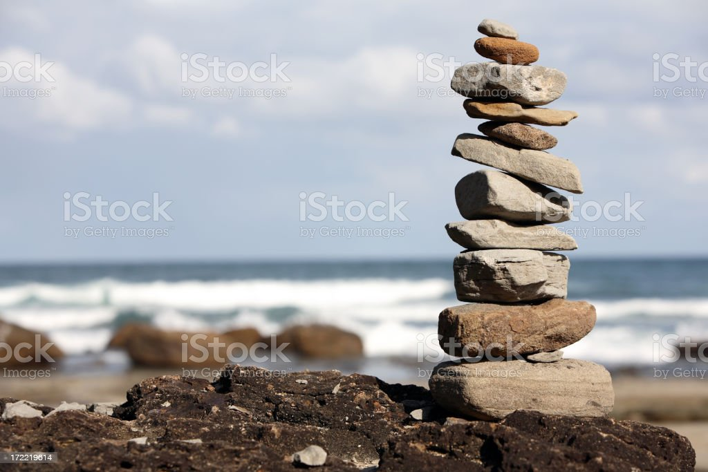 Different types of rocks stacked on the beach stock photo