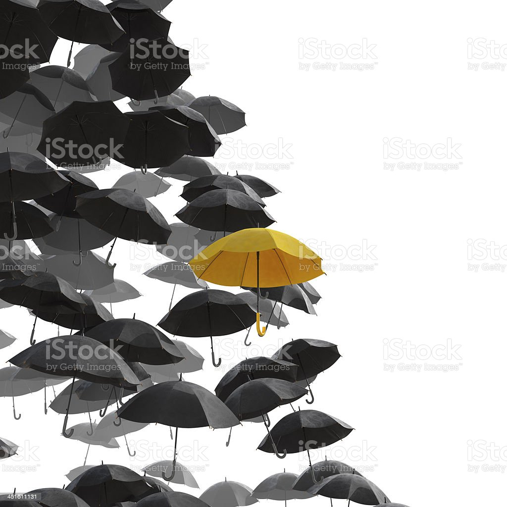 Different umbrella in yellow stock photo