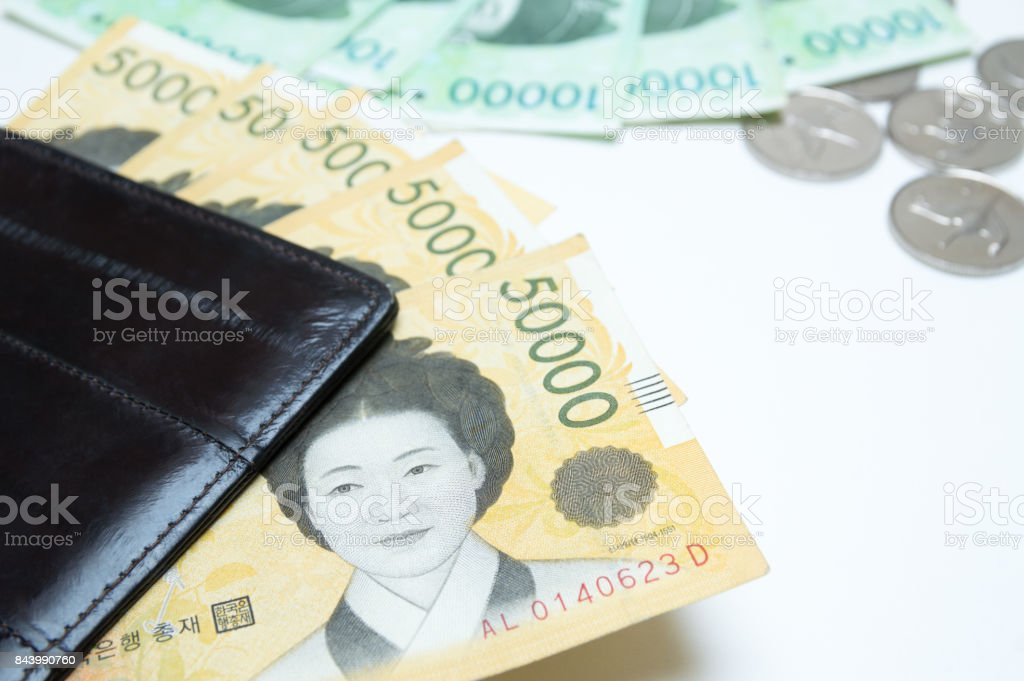 Different value South korean won currency near the wallet on white background stock photo