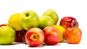 Different varieties of apples over white