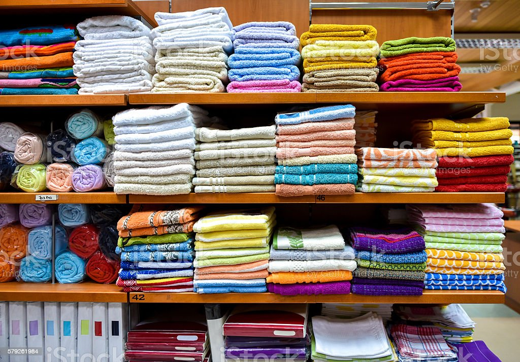 Different variety of colorful towels piled in factory department stock photo