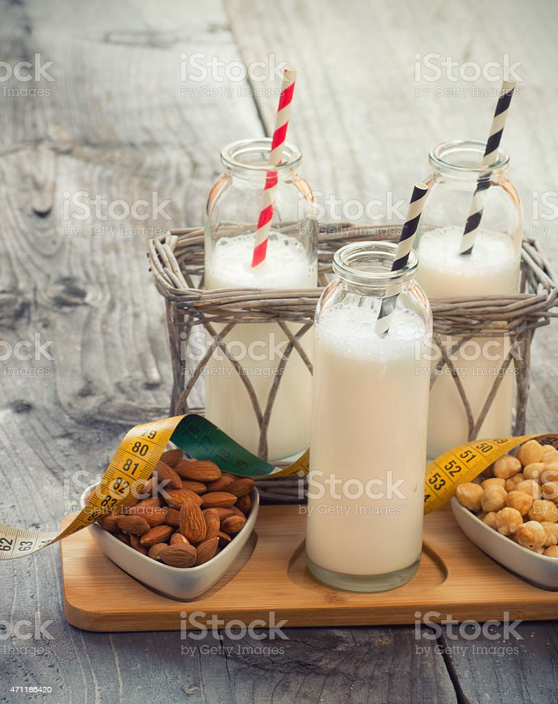 Different vegan milks on a table. Substitute for dairy milk. stock photo