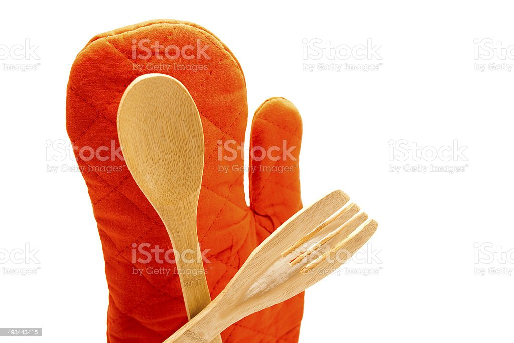 Different Wooden Spoon with Red Potholder Glove stock photo