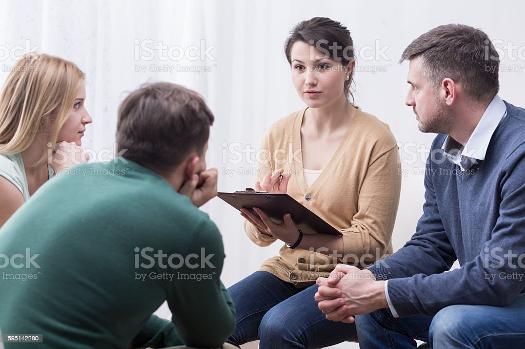 Difficult but satisfying role of a support group moderator stock photo