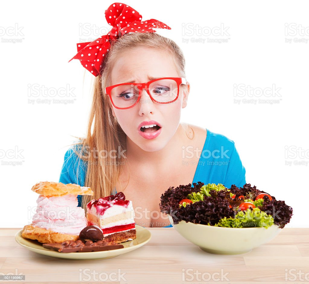 Difficult choice between junk and healthy food stock photo
