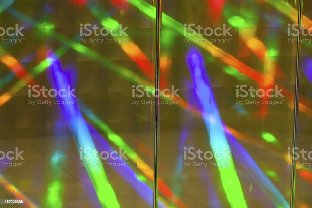 Diffracted rainbow light colours reflected from a prismatic wall stock photo