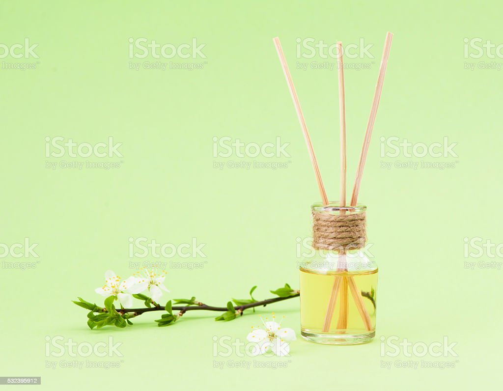 diffuser with wooden sticks stock photo