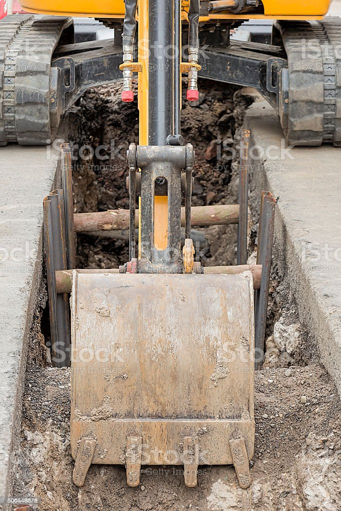 Digger in city stock photo