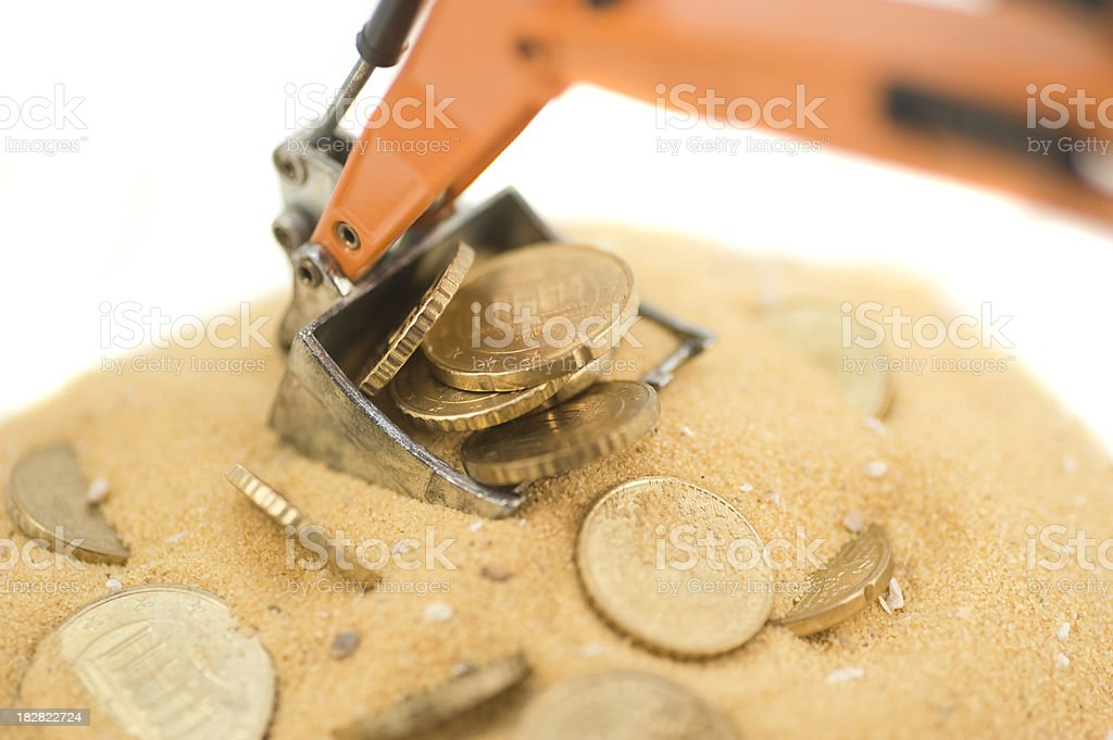 digger with coins and sand royalty-free stock photo
