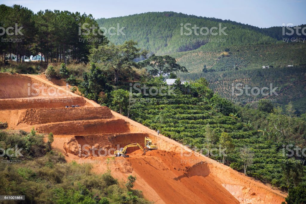 Diggers excavate terraces for coffee beans plantations in Vietnam stock photo