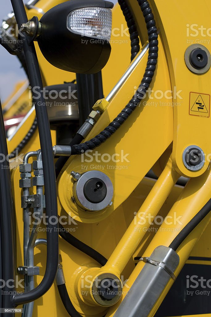 Digger's hydraulic hoses royalty-free stock photo