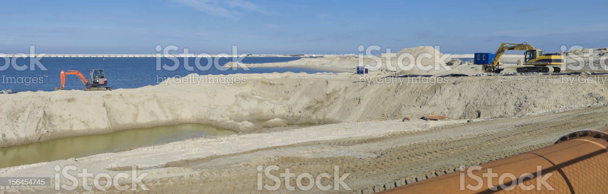 diggers on the shore royalty-free stock photo