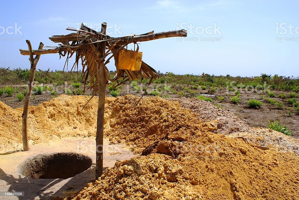 digging a well in Africa stock photo