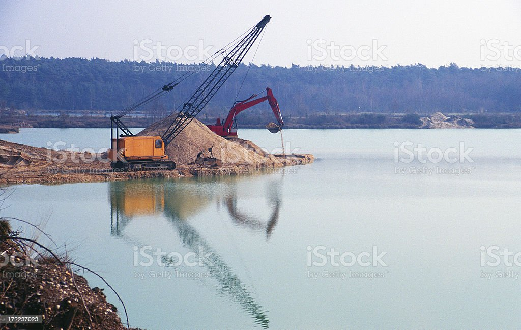 Digging a wet hole stock photo