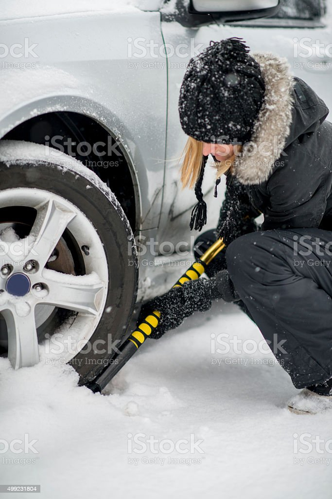 Digging Her Car Out of the Snow stock photo