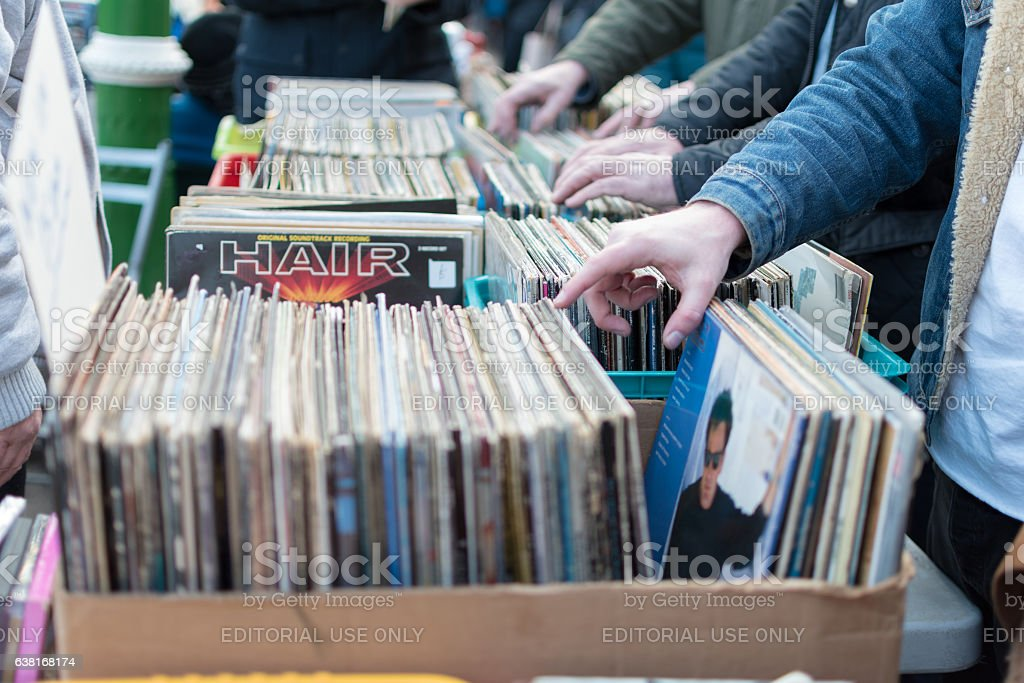 Digging in the crates stock photo