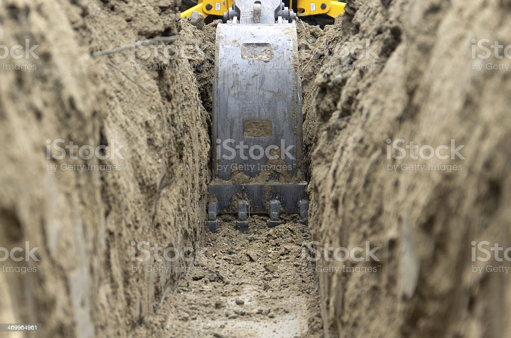 Digging Power Line Trench stock photo