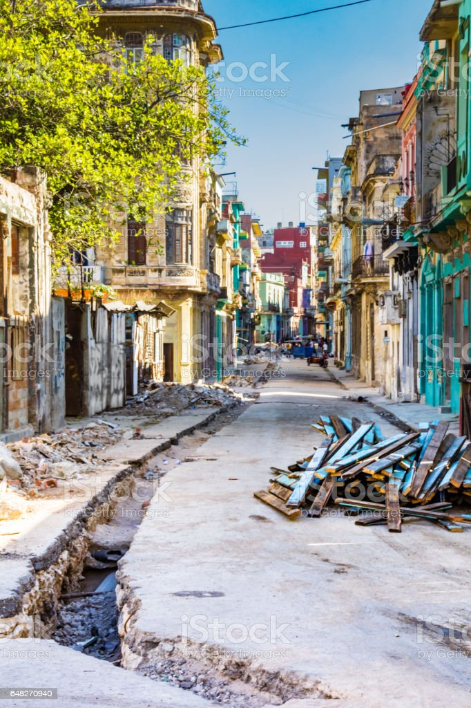 Digging the streets of Old Havana, Cuba. Poverty and streets under construction. stock photo