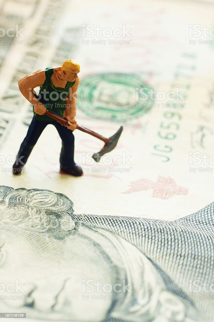 Digging US Currency - Tiny Workman royalty-free stock photo