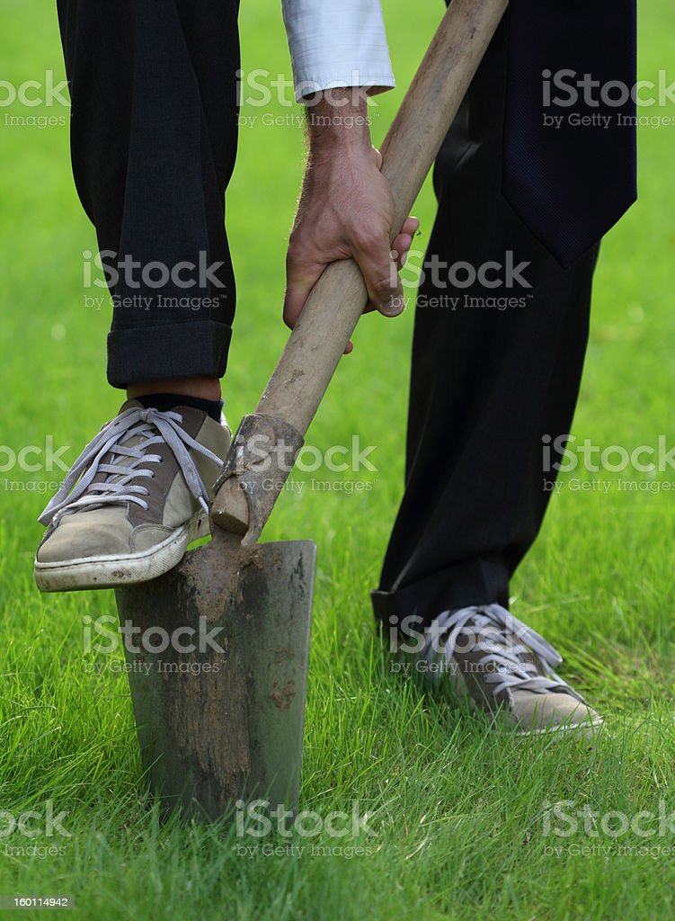 Digging with a shovel stock photo