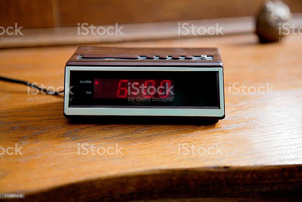 Digital alarm clock showing 6.00am stock photo