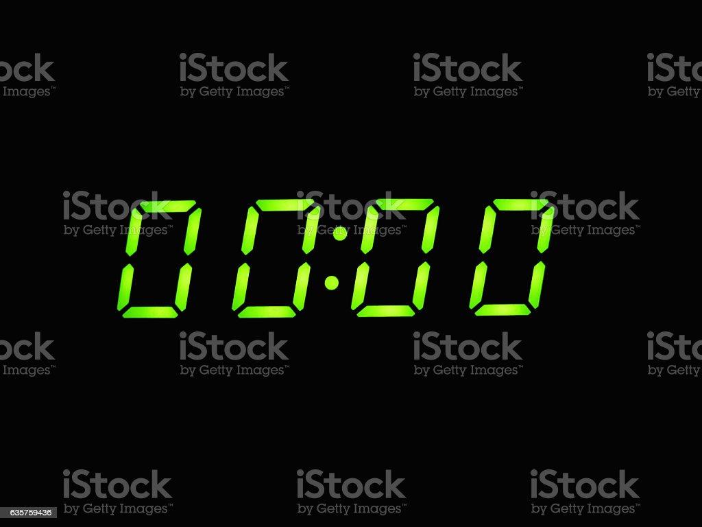 digital alarm clock with green digits stock photo