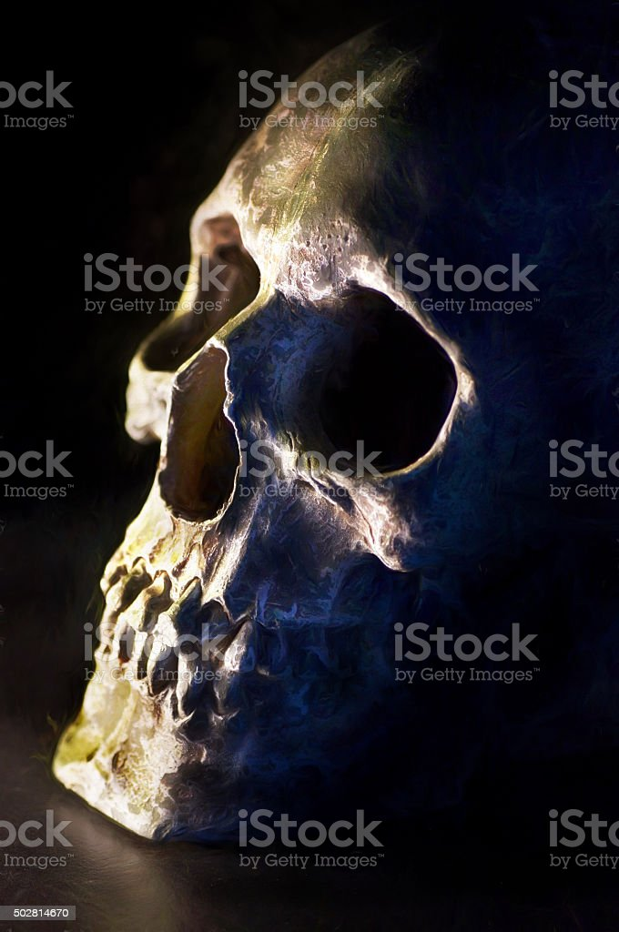 Digital art, paint effect, cracked and damaged human skull stock photo