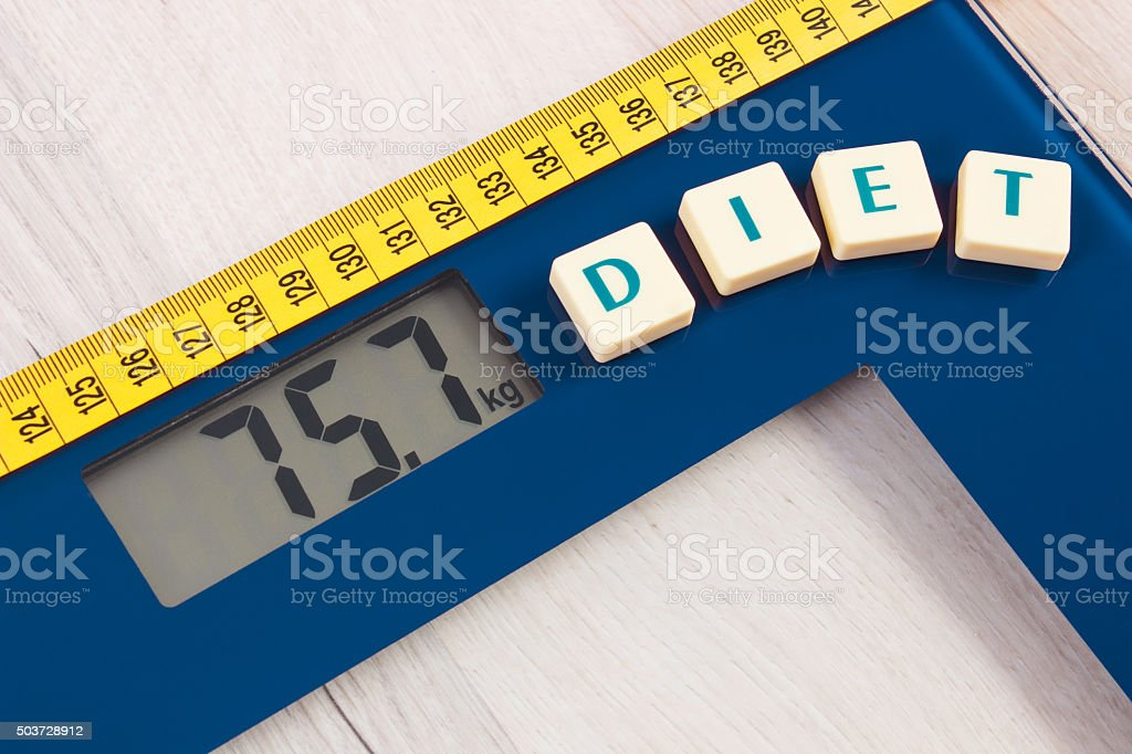 Digital bathroom scale with tape measure, slimming concept stock photo