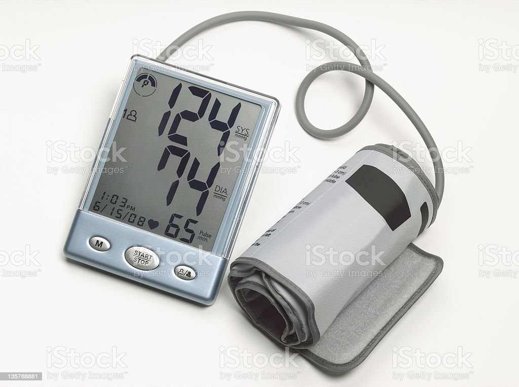 Digital blood pressure monitor & cuff on white royalty-free stock photo