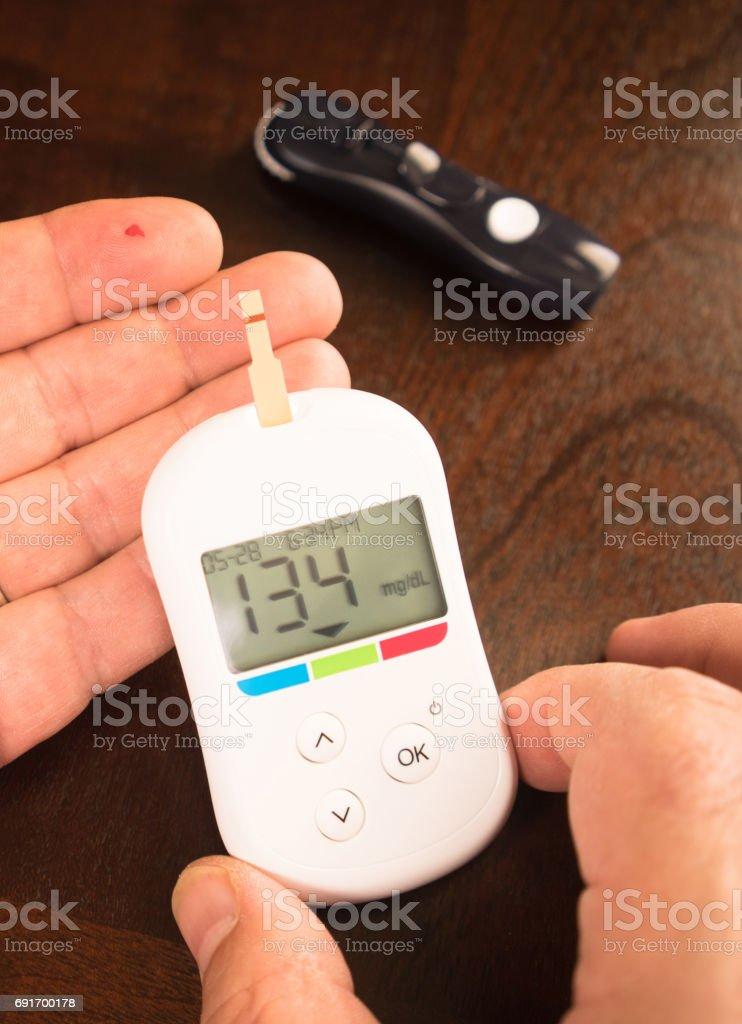 Digital Blood Sugar Glucose Tester Diabetic Fingertip Test stock photo