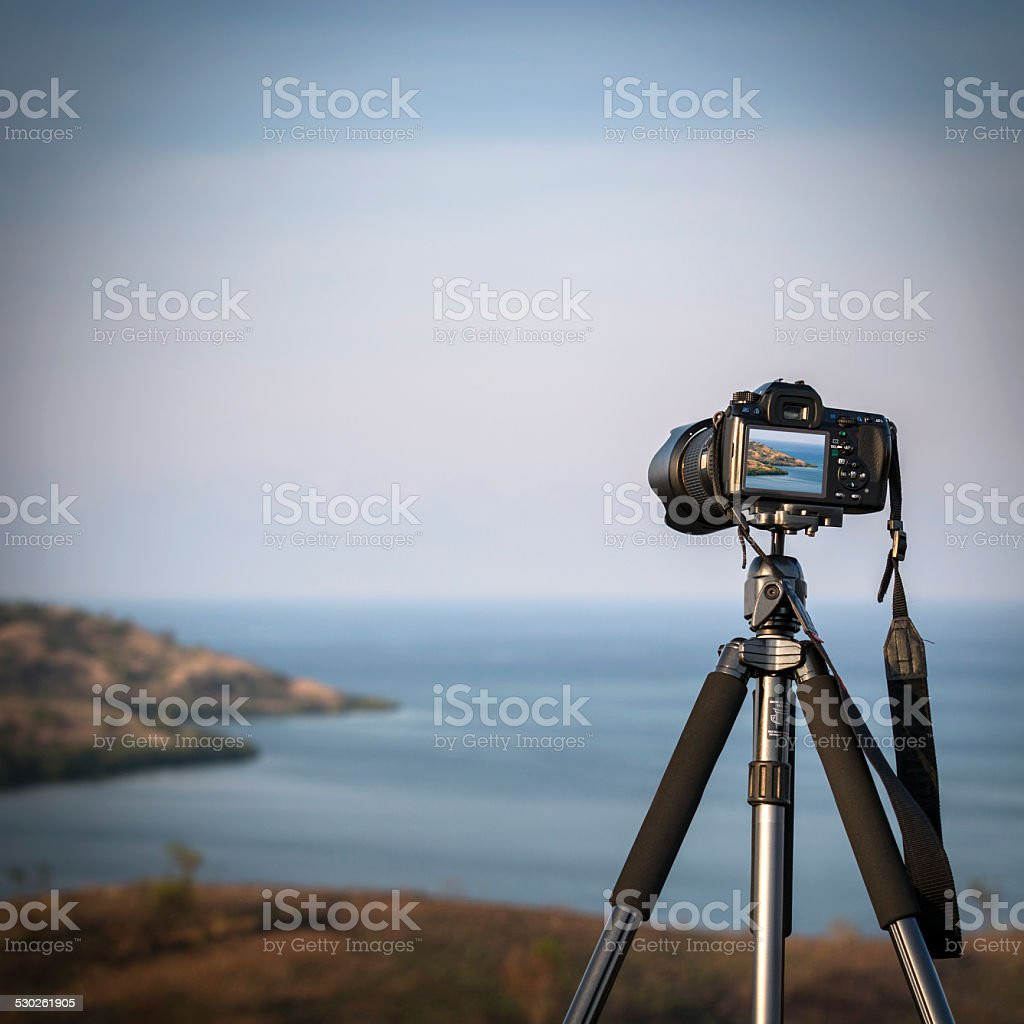 Digital camera on mounted on tripod stock photo