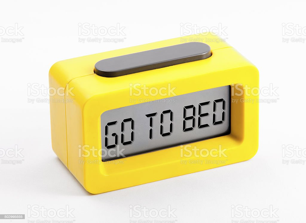 digital clock with go to bed message stock photo