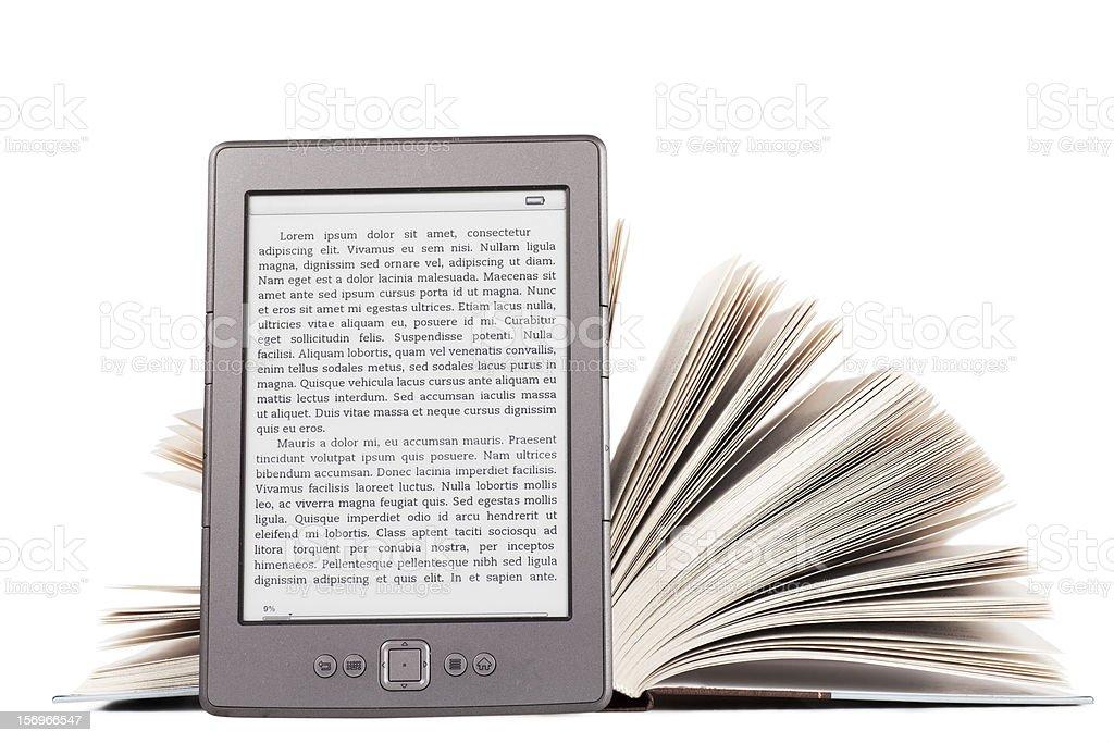 A digital e-reader against a hardback book stock photo