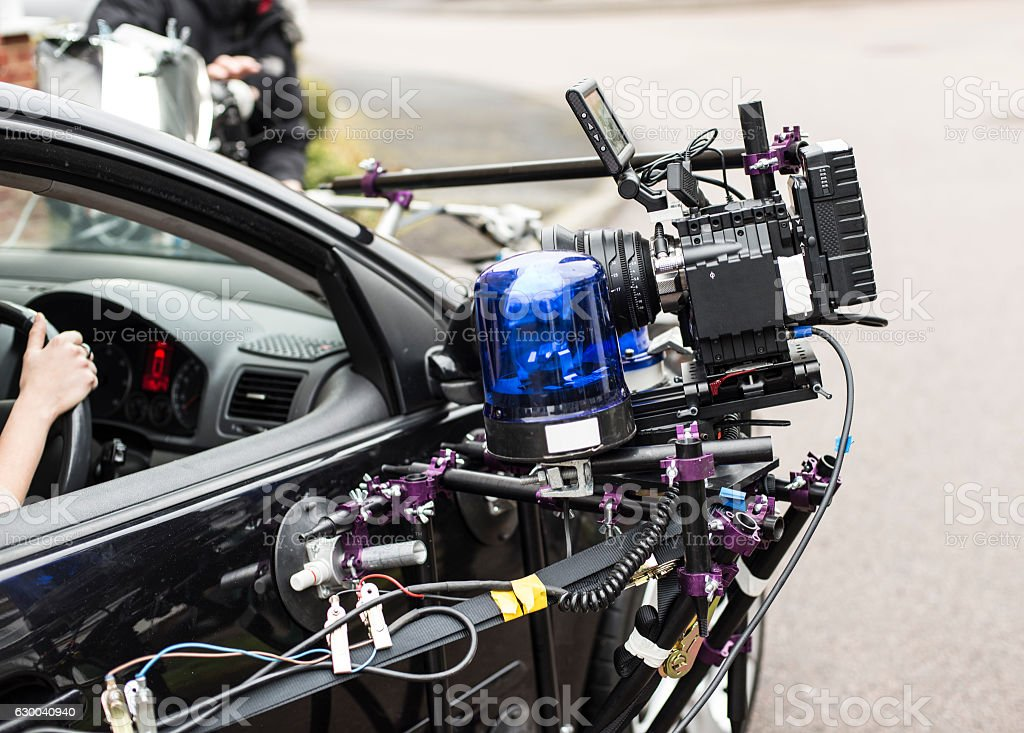 Digital film camera on set, on car mount. stock photo