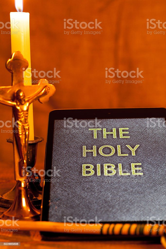 Digital holy bible on tablet computer stock photo